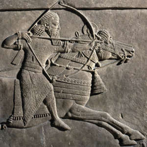 Ashurbanipal, last major ruler of the Assyrian Empire, depicted in the royal lion hunt bas-reliefs (c. 645 BCE) that were ripped from the walls of the North Palace at Nineveh during excavations in the mid 19th century and shipped to the British Museum. The bas-reliefs are widely regarded as