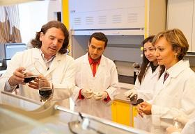 Adham Ramadan and his team in the lab.
