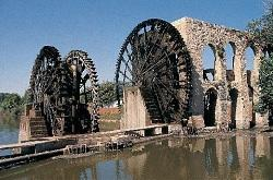 The famous water-wheels, or nourias, of the city of Hama in Syria.